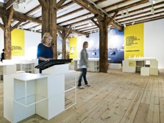 """<p>The modular GRID was utilised as display and seating units for the 2010 exhibition 'What makes a livable city' by Danish Architecture Centre. White GRID components were designed into info stands, display podiums, and benches. The exhibition interior fitted beautifully into the surrounding space with wooden floor and ceiling, and the exhibition interior formed the visitor """"walking flow"""" through the exhibition.</p> <p>Client: Danish Architecture Centre<br /> Location: Copenhagen, Denmark<br /> Photos: Danish Architecture Centre</p>"""