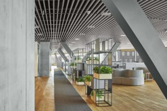 <p>DLA Piper is a full-service law firm providing legal advice to the corporate and public sector. At their Aarhus based open-plan office, GRID is included as room dividers at individual work stations and separating desk-work areas and break-out/short meeting areas. Planters are added to the room dividers and by combining oak, anthracite, fjord and black, units are designed to fit into the overall office design.</p> <p>Client: DLA Piper<br /> Location: Dokk1 Aarhus, Denmark<br /> Architect: Design Studio Lars Vejen<br /> Photos: Dejan Alankhan</p>