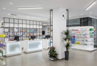<p>Farmacia Sud opened in 2016 on the ground floor of a renovated building. The main interior challange was to integrate the pharmacy store area and a more undisturbed back office area in the same room. Architects from d'Estudio Arquitectura devised and executed the GRID system as a multi-functioning space dividing wall to accommodate this challange. Additional side tables and upholstered seats were specified for the project.</p> <p><em>Client:</em> Farmacia Sud<br /> <em>Location: </em>Valéncia, Spain<em><br /> Architect: d</em>'Estudio Arquitectura<em><br /> </em><em>Photos: </em>GERMAN CABO</p>