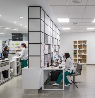 <p>Farmacia Sud opened in 2016 on the ground floor of a renovated building. The main interior challange was to integrate the pharmacy store area and a more undisturbed back office area in the same room. Architects from d'Estudio Arquitectura devised and executed the GRID system as a multi-functioning space dividing wall to accommodate this challange. Additional side tables and upholstered seats were specified for the project.</p> <p>Client: Farmacia Sud<br /> Location: Valéncia, Spain<em><br /> </em>Architect: d'Estudio Arquitectura<em><br /> </em>Photos: GERMAN CABO</p>