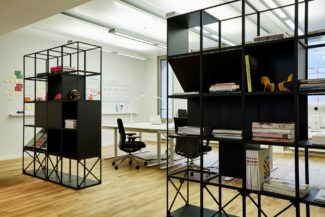 "<p style=""line-height: 21px; margin-top: 0px;"">The Münich based architect firm INPULS designed black room dividers and a white wall standing unit for the leading ad agency McCANN's Düsseldorf office. The room dividers were customised with magazine shelves, cross-braces and room for storage. In common for all units are the well defined lines.</p> <p style=""line-height: 21px; margin-top: 0px;"">Client: McCANN, Düsseldorf<br /> Location: Düsseldorf, Germany<br /> Architect: INPULS<br /> Photos: A.Green</p>"