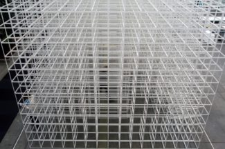 "<div class=""page_content right25""> <p>'Empty Space' was an installation made by artist Olafur Eliasson in 2004 for Scandinavian Furniture Fair. The idea was to create a passage when removing GRID elements from a massif. Walking through, visitors became part of the interactive installation. The inspiration arose from GRID's designer Peter J. Lassen's vision that GRID as a system only works through interaction with the user.</p> <p>Client: Scandinavian Furniture Fair<br /> Location: Bella Center, Copenhagen, Denmark<br /> Artist: Olafur Eliasson<br /> Photo: Lars Norman</p> </div>"