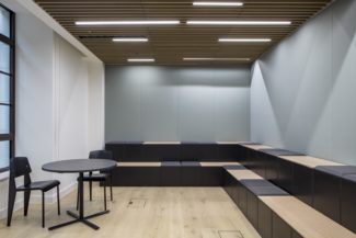 <p>A two-level seating furniture was specified for the presentation space at Bristows' London based office. Moving into new premises in 2018, Bristows wanted an office space that reflects their corporate identity and a place that offers more flexible, agile and motivating working environments for staff and partners. Perkins + Will and Salt & Pegram in collaboration with furniture supplier Icons of Denmark selected the modular GRID as seating perfect for presentations, staff training and short meetings. The furniture unit was designed with a closed base and with black upholstered seats as well as unpadded oak panels.</p> <p>Client: Bristows<br /> Designer: Perkins + Will<br /> Dealer: Salt & Pegram</p>