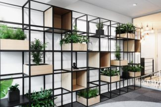 <p>Bank Sparekassen Thy opened a new branch in Viborg, Denmark in 2018. ERIKarkitekter were given the challenge of designing the new interior. The brief included devising a client meeting area that allowed for discretion within the otherwise open-plan space. GRID was specified to form this multi-functioning room-in-room space. Freestanding and wall standing units were designed with oak display boxes and oak plant boxes. ERIKarkitekter were able to create a space where clients can discuss financial matters discretely, divided from the rest of the office while still enjoying the openness of the entire space.</p> <p>Client: Bank Sparekassen Thy<br /> Location: Viborg, Denmark<br /> Architect: ERIKarkitekter<br /> Contractor: Redoffice Konpap<br /> Photo: Joakim Olsen</p>