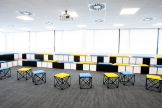 "<p>For the University of West Scotland's (UWS) new Lanarkshire Campus in Hamilton International Technology Park, Alpha Scotland specified GRID for the lecture area. A black and white GRID structure and freestanding mobile units were chosen as seating. All with special coloured cushions. UWS is a world leading research institute with an international focus and a visionary approach to technology and innovation. In that sense the university wanted the interior to be motivational and inspiring for students and staff.</p> <p>Client: University of West Scotland<br /> Location: Hamilton, Lanarkshire Campus<br /> Dealer: <span class=""meta-value"">Alpha Scotland</span><br /> Photographer: UWS</p>"